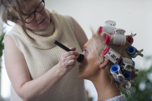 Kerrie Bailey (HMU) applying the finishing touches of make-up