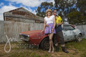 "Denise and Greg in front of the ""Firebird"" and corrugated iron for days...."