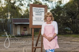 An advertisement for the Stawell Show was erected beside the road, in front of Denise's little house