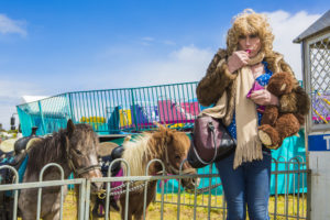 Denise takes a break, next to the shetland ponies, to re-apply make-up. A girl has to look her best.
