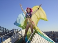 Courtney Act on top of the largest sail of the Opera House - for SGLMG and Destination NSW